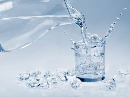 Water in glass with ice photo