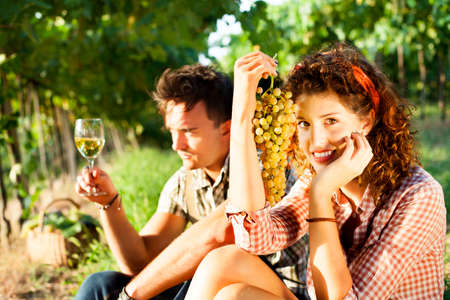 farming couple relaxing after the grape harvest photo