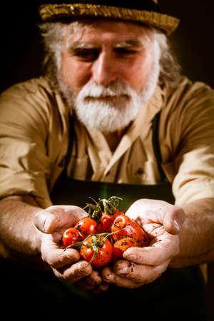 farmer shows his biological vegetables photo