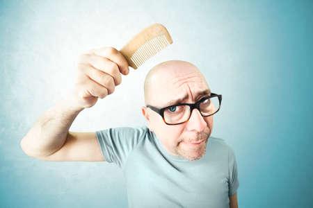 comb: nostalgic man comb his bald head in the moring