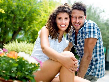 couple having fun:   young couple  having fun in a greenhouse  Stock Photo