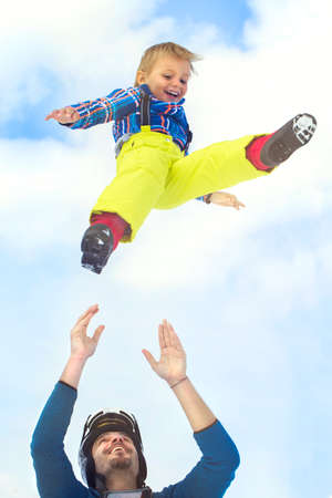 hurl: father launching his son up in to the sky