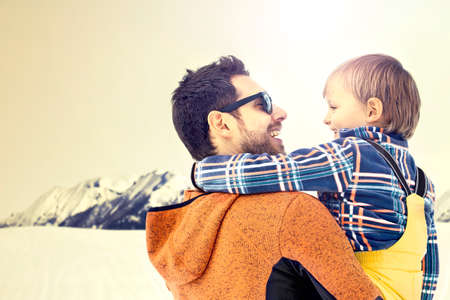 father carring his son to wanderfull winter landscapes, growing