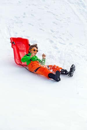 雪の上楽しんで少年 写真素材