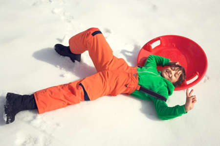 bobsled: young boy having fun with his bobsled Stock Photo