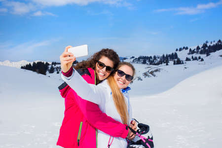 friends having a selfie on the snow photo
