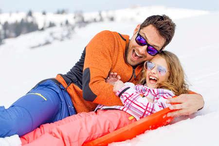 女の子と彼の父を非常に高速にそり 写真素材
