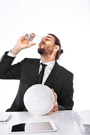 Alcholized business man celebrate football victory