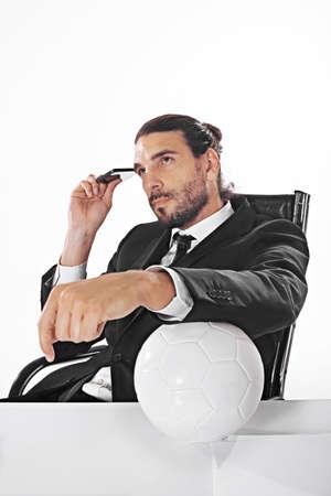 サッカーの試合を賭けの代理業務ビジネスの男性 写真素材