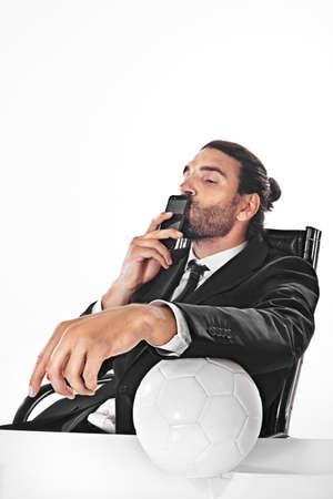 Procurator business man bets on a football match Reklamní fotografie