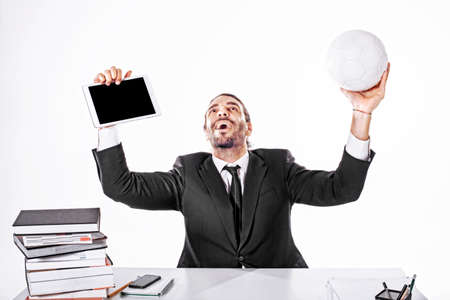 Business Man Bet on football match while working