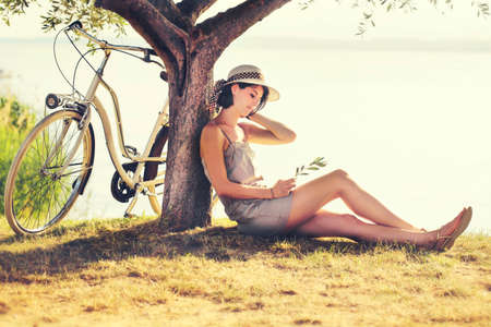 leisure time: Beautiful dormant woman in love enjoyng the sunset Stock Photo