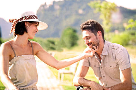 handlebars: Couple having a bicycles ride into the nature Stock Photo