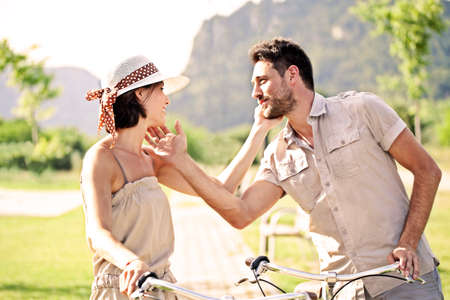 garda: Couple having a bicycles ride into the nature Stock Photo