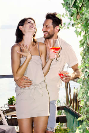 couple in love having spritz time with lake view photo