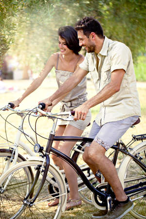 couple having fun by bike on holiday to the lake in Italy photo