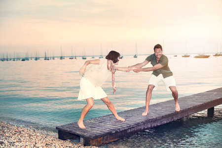 courtship: man try to push her woman into water
