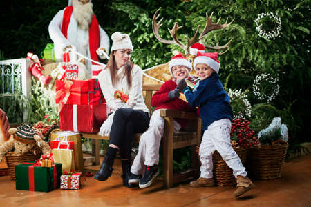 young brothers playing at the home of Santa Claus photo