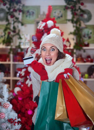 crazy woman with her credit card and christmas gifts photo