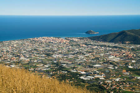 Wide view of the city of Albenga and the Gallinara island Stock Photo