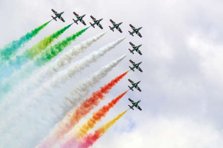 tricolor arrows in  Acrobatics with smoke, may 18 2014 in Loano - Savona Italy