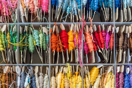box full of skeins of embroidery