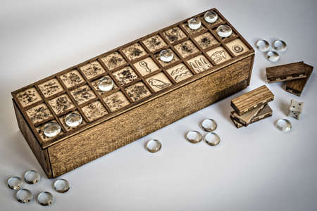 Senet boardgame with dice and pawn