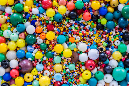 thousands of colored beads scattered