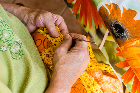 old lady embroidered a crochet tray with love Stock Photo
