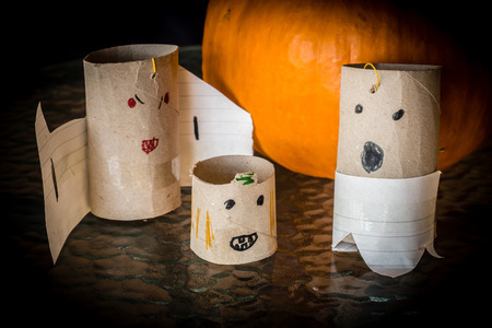 Childish decoration for Halloween, made with paper and cardboard rolls