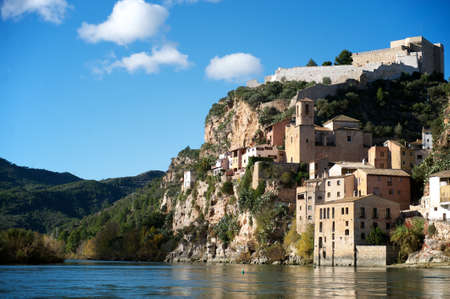 medieval village with castle used by Moors, Templars and Hospitaliers, and stone buildings on the banks of the river Ebro, Ribera de l Ebre  aka Ribera del Ebro , province of Tarragona, Catalonia, Spain Editorial