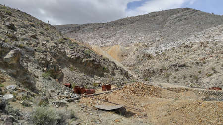Historical Lost Burro gold mine in Death Valley National Park, California, lays the old mining environmental waste of metal and wood debris.