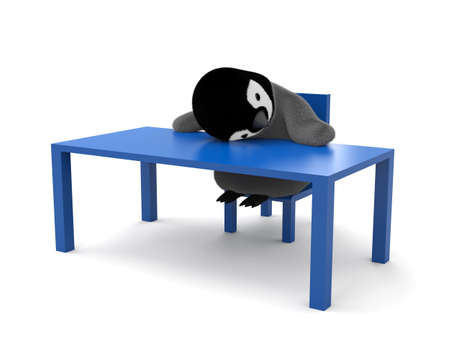Tired penguin laying on the table Banco de Imagens