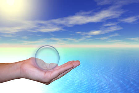 A hand holding a sphere above the sea under the sunny sky