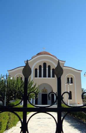 A big orthodox church behind the iron gate photo
