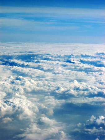 Blue sky above the clouds while flying under the sun Stock Photo - 1860579