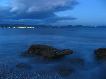 A beautiful beach at the sunset with rocks in the foreground