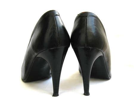 Female black high heel shoes isolated on white background