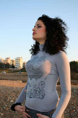 A beautiful brunette female model at the beach photo