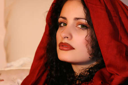 A beautiful young brunette female with red scarf