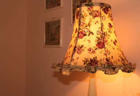 bedside lamp: A  bedside lamp with small roses Stock Photo