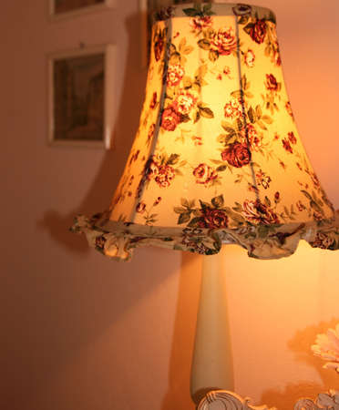 illuminative: A  bedside lamp with small roses Stock Photo