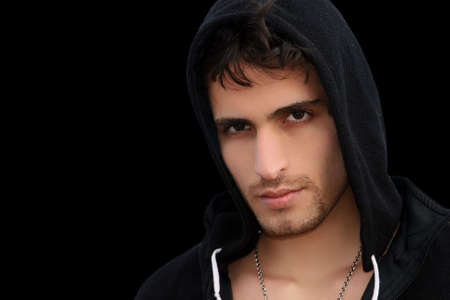 A young attractive man isolated on black background Stock Photo