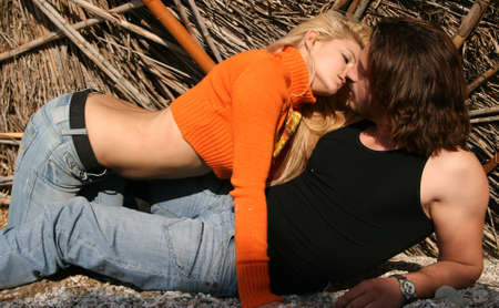 sexual couple: A young blonde couple lying in a  pose Stock Photo
