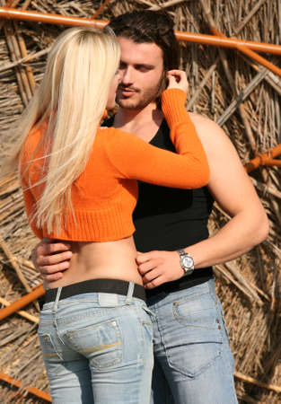 A young blonde couple hugging each other photo