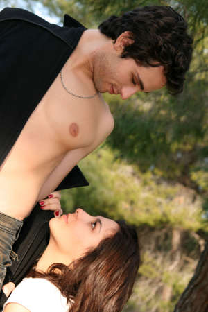 Young woman on her knees in front of a man Stock Photo