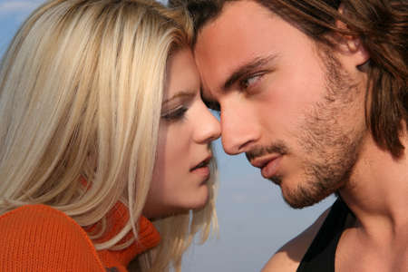 Young blonde couple in love ready to kiss