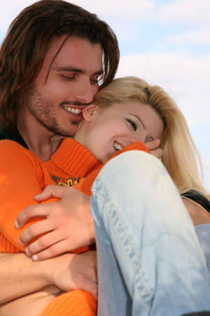 A young couple in love hugging and laughing happy