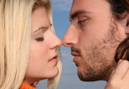 romantic kiss: A young couple in love kissing outdoors