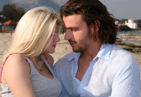 Young blonde couple in love looking each other